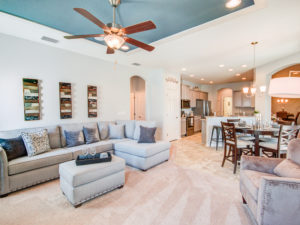 Spacious family room and kitchen in the Williamson II - Available at Summercrest - New homes in Ocala