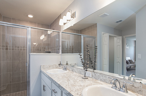 Vanity lighting in owner's bath of Highland Homes' Serendipity model home in Winter Haven, FL