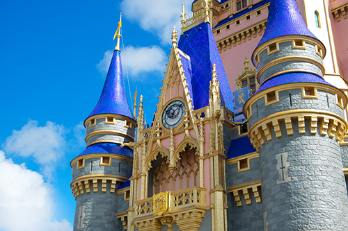 Middle of Cinderella Castle in Disney World in it's new rose gold and grey brick colors