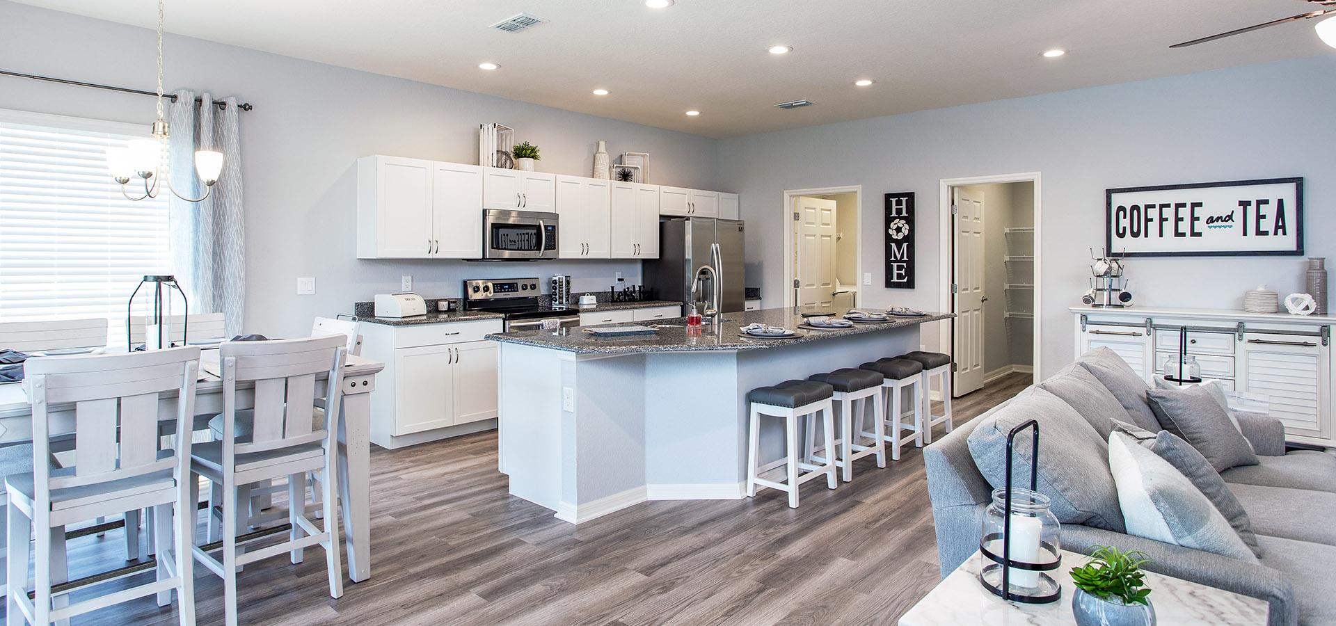 Open layout with kitchen, dining, and living area from Highland Homes