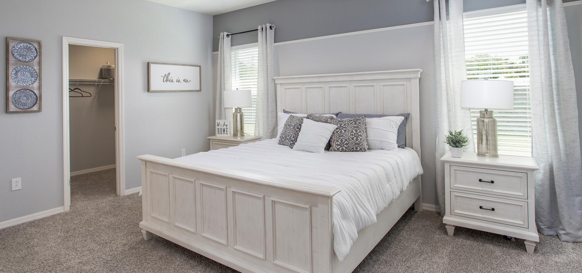 Luxurious primary bedroom with walk-in closet