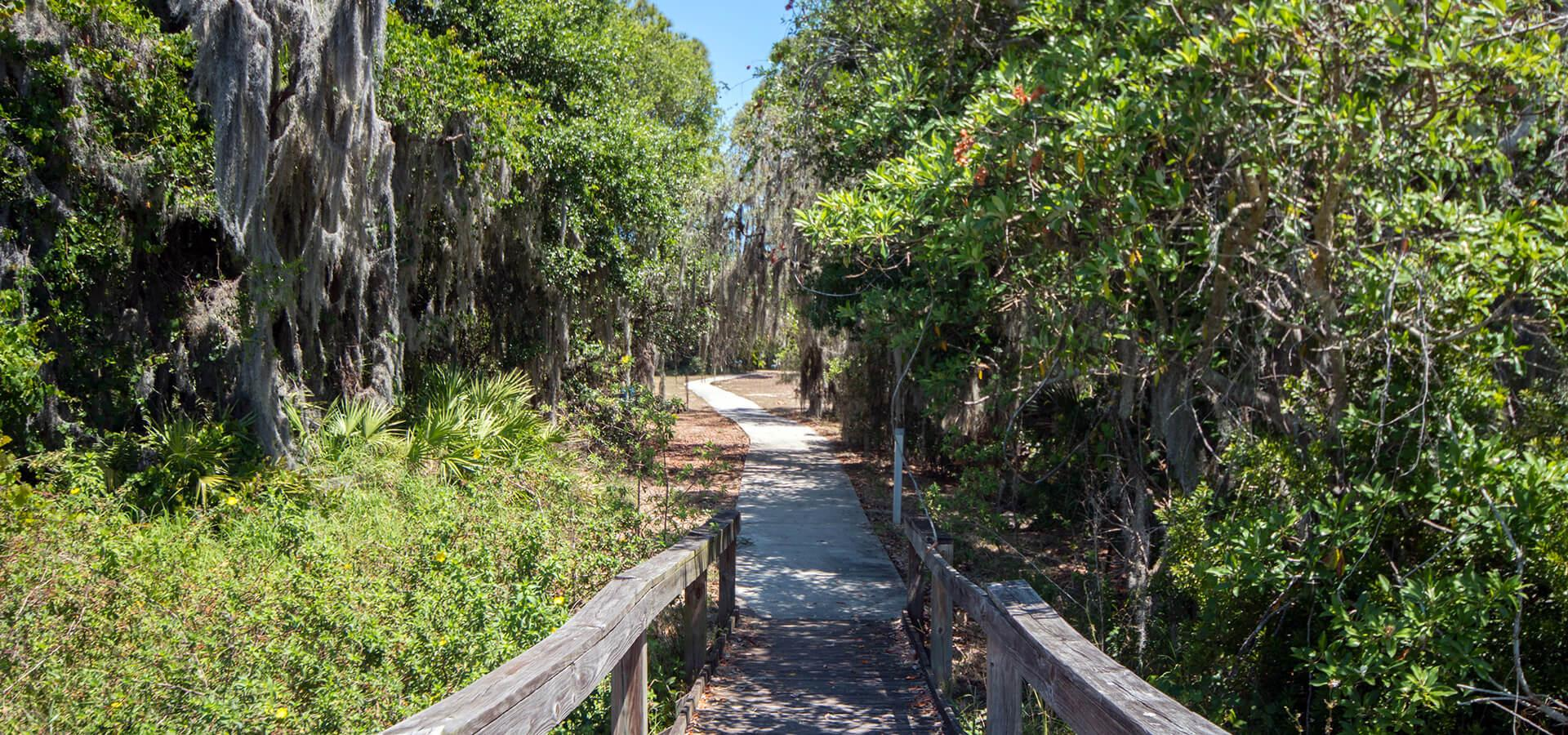 Mackay Gardens and Lakeside Preserve, across the street from homes for sale in Lake Alfred, FL at The Lakes