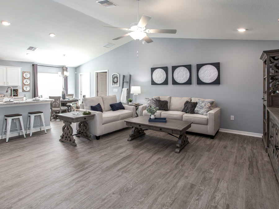 Armstrong Lakehouse Hickory Alpine Frost Luxury Wood Vinyl Plank Flooring in a living area