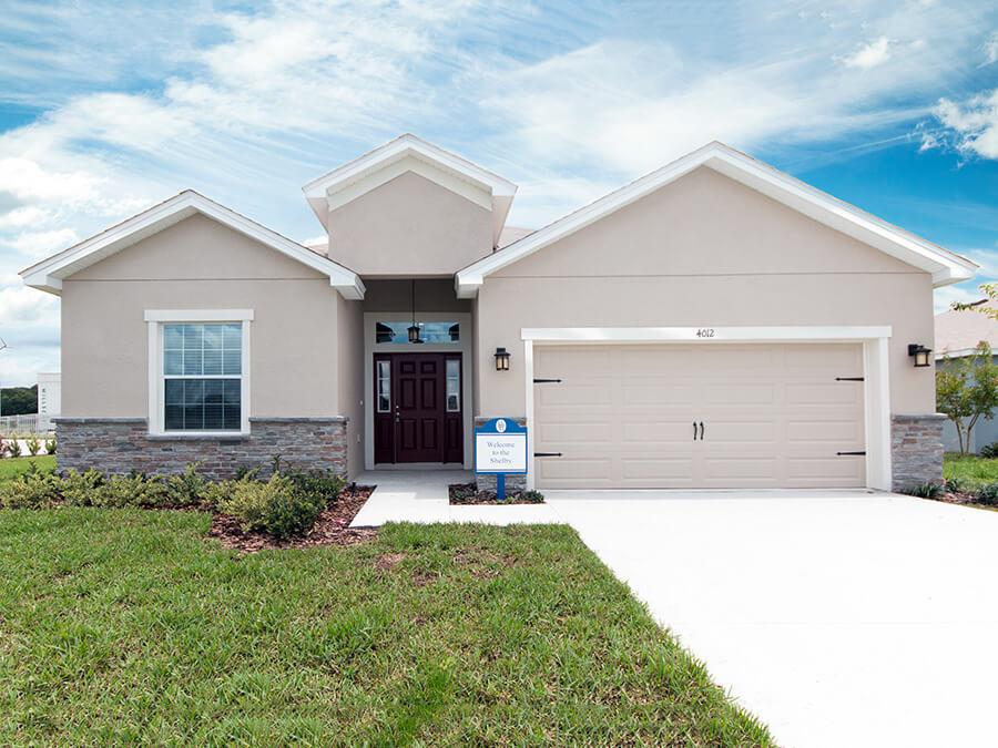Florida home with a dark red front door